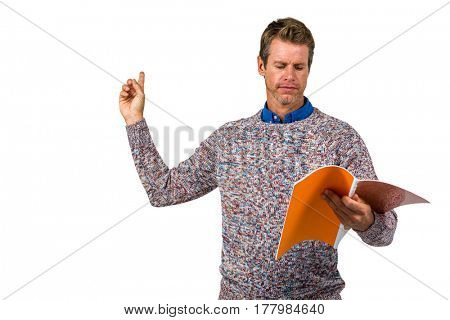 Close-up of man reading book against white background