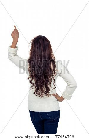 Rear view of brunette pointing up on white screen