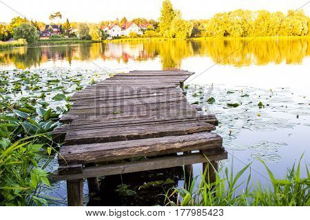 Small Fishing Pier In The Sunset On The Pond. Calm June Summer Afternoon. Ideal Place For Fishing. E