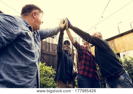 Group of people hands together support team unity