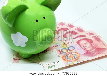 Green Piggy Bank With China Currency