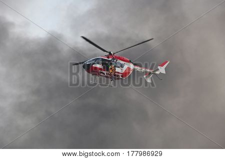 aviation rescue helicopter on blue sky background
