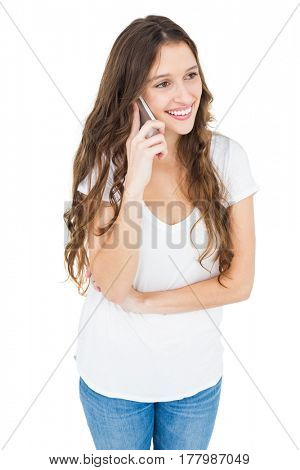 Smiling woman having a phone call on white background