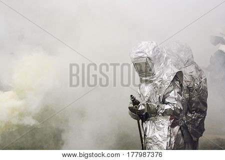 People  In Suit Of Protection Against Fire