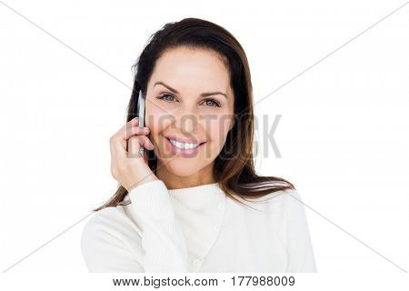 Cheerful brunette with her mobile phone calling someone on white background