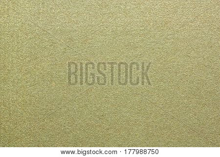 Painted empty sheet of plywood , textured wall, blank background, Wallpaper. Shiny decorative paper texture. Horizontal location. Abstract gold backdrop for your design.