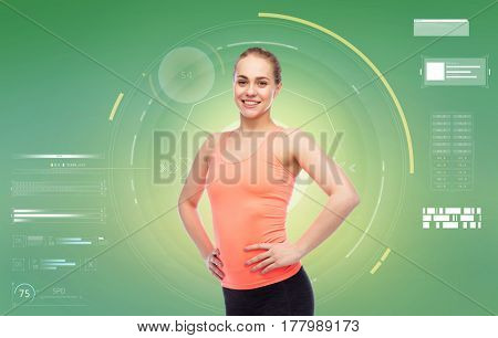 sport, fitness, technology and people concept - happy smiling sportive young woman over green background