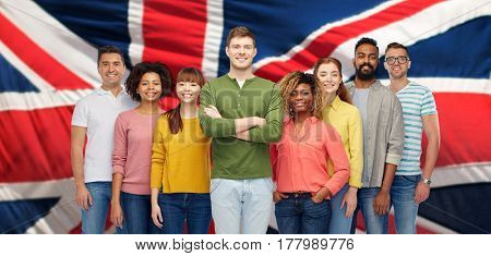 diversity, race, ethnicity, immigration and people concept - international group of happy smiling men and women over english flag background