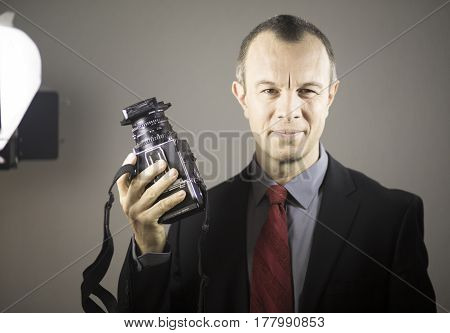Photographer In Studio In Suit