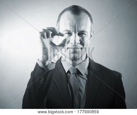 Businessman executive in suit shirt and tie formal clothing aged in 40's against plain studio portrait background.