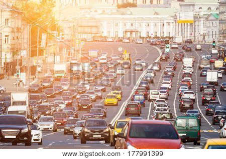 Rows of cars on a congestion street with warm sunlight