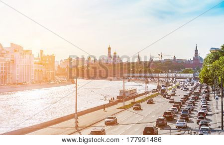 MOSCOW - MAY 16: Traffic jam on Moskvoretskaya embankment with Kremlin on the background on May 16 2014 in Moscow. Moscow is one of the most traffic congested cities especially during rush hours.