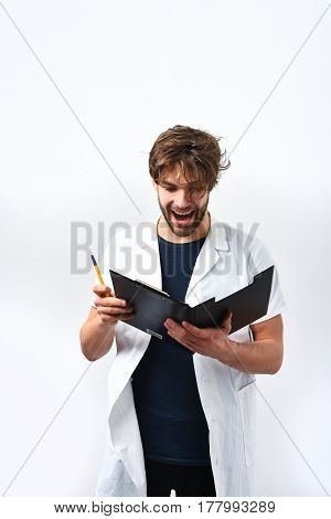 Bearded Caucasian Doctor Or Postgraduate Student With Clipboard And Pen