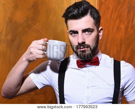 Bearded Man Holding Cup Of Tea, Coffee With Serious Face