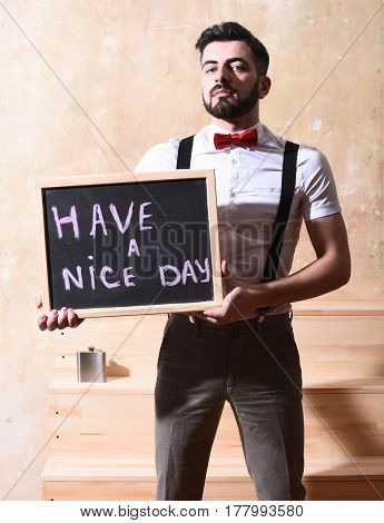 Bearded Man Holding Board With Inscription With Serious Face