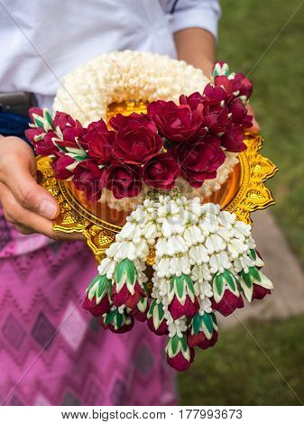 Lei of flowers for worship in Buddhist way