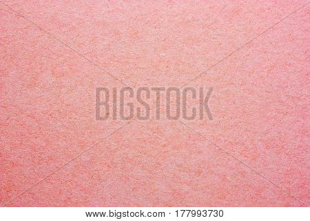 A blank sheet of paper or plywood pink color. Rough surface of background. Concept of recycling raw materials. Natural paper background texture for your design. Rustic, vintage style. Horizontal.