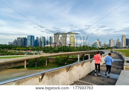 People jogging at morning in Singapore. Singapore Downtown Core in the background.