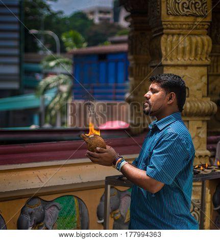 Kuala Lumpur, Malaysia - Circa October 2014 - Portrait of an unidentified local Hindu man praying at one of the Hindu temples in Kuala Lumpur, Malaysia