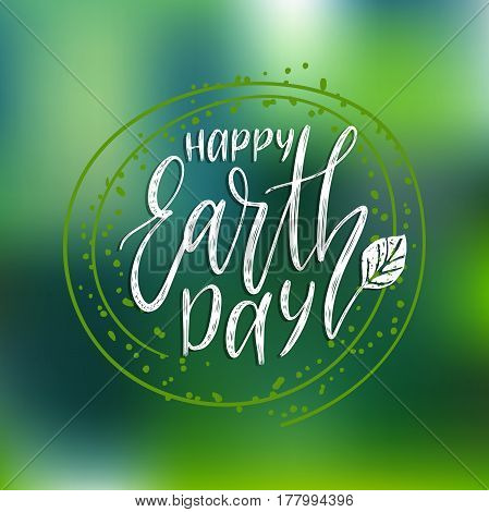 Happy Earth Day hand lettering on blurred background. Vector illustration with leaves for greeting card, poster, etc