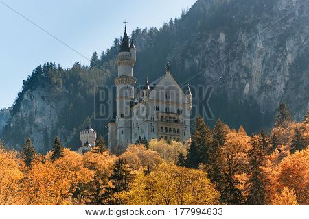 Beautiful view of the Neuschwanstein castle in autumn. Palace situated in Bavaria Germany. Neuschwanstein is one of the most popular of all palaces and castles in Germany Europe and world.