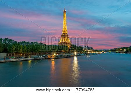 PARIS FRANCE - May 8 2016 : Cityscape of Paris France with Eiffel Tower at night on . The Eiffel tower is the most visited monument of France with about 6 million visitors every year.