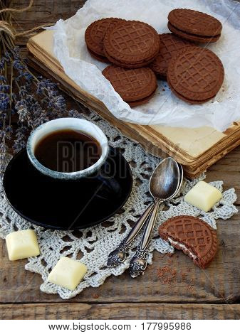 Romantic Composition Of Chocolate Cookies With White Cream, Cup Of Coffee And Bouquet Lavender On Wo
