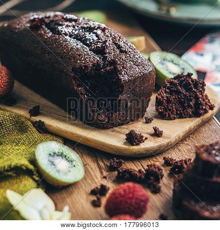 Chocolate Loaf cake with kiwi on background