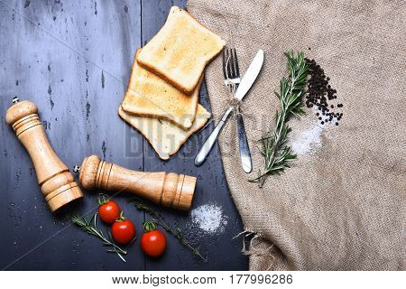 Fried Toast Bread, Pepperbox, Saltcellar, Rosemary, Thyme, Tomato On Burlap