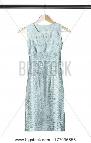 Elegant lacy blue sleeveless dress on wooden clothes rack isolated over white