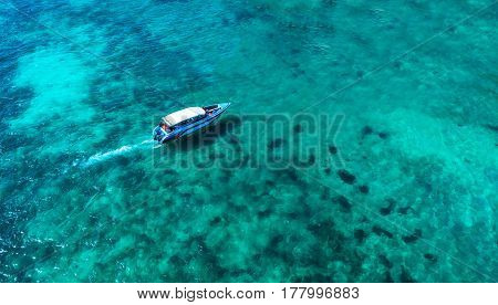 Speed boat in the sea.Aerial view. Top view.amazing nature background.The color of the water and beautifully bright.