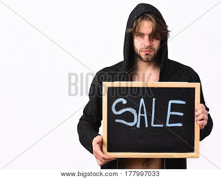 Bearded man short beard. Caucasian sexy young macho with stylish hair and moustache holding black board with sale inscription in hood isolated on white studio background copy space