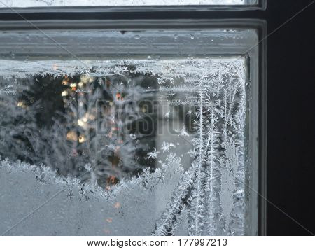 After a cold night there's frost on the glass pane.