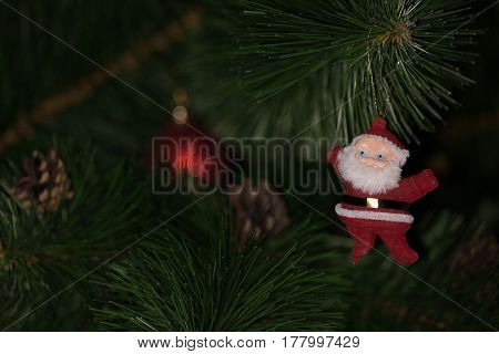 Toy hanging on the Christmas tree. Toy of Santa Claus.
