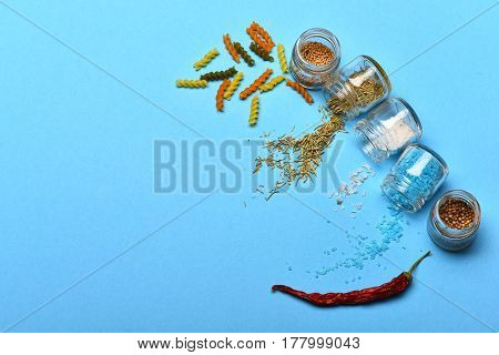 Salt, Spices And Herbs Spilled From Jars And Dried Fusilli