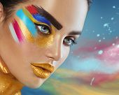 Fashion Model Girl with colored face painted. Beauty fashion art portrait of beautiful woman with colorful abstract makeup. Vivid paint make-up, bright colors. Vogue style lady face, Multicolor design poster