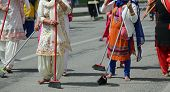 many Sikhs women barefoot while scavenging the road during a Sikh festival poster