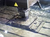 operator use copper EDM electrod to make precision mold and die poster