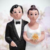 closeup of a couple wedding cake topper