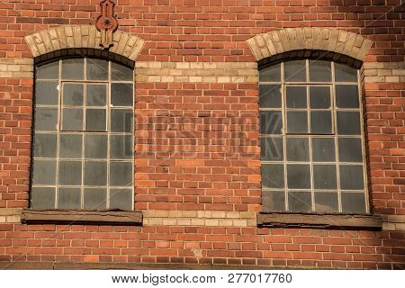 Old Empty Brick House Factory With Dark Windows