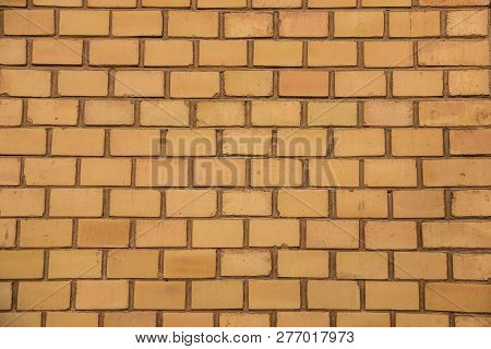 Old Empty Brick House Factory Wall With Yellow Bricks