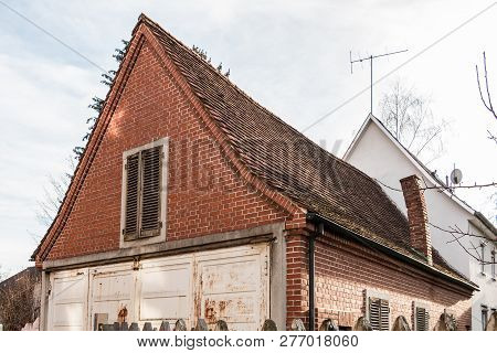 Old Empty Brick House With Crooked Chimney