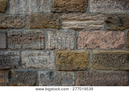 Old Wall Of A Historical Building With Different Colored Stones