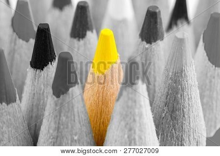 Leader Concept. The Man Of Creativity. Yellow Pencil On A Background Of Black And White Pencils.