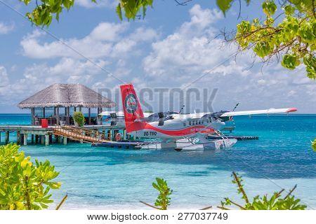 05.07.2018 - Ari Atoll, Maldives: Exotic Scene With Seaplane On Maldives Sea Landing. Vacation Or Ho