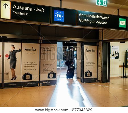 Hamburg, Germany - Mar 20, 2018: Businessman Exiting Airport Terminal Through Nothing To Declare Gat