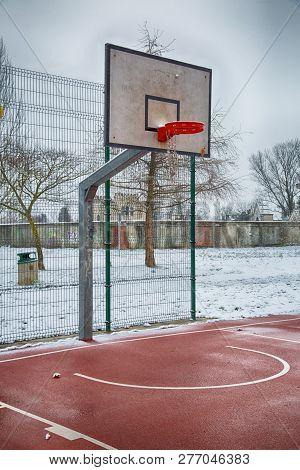 Basket Of Playground In Winter Season, Vertical Image