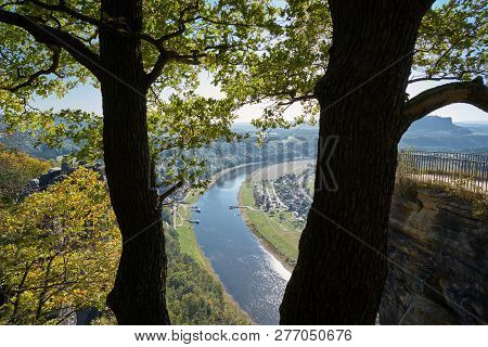 Look To The Valley Of The Elbe River With The Small Town Rathen From A Rock In The Elbe Sandstone Mo