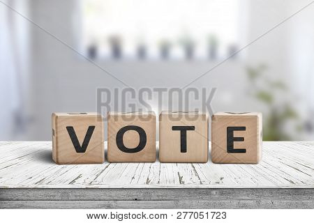 Vote Sign Made Of Wood In A Bright Room On A White Table