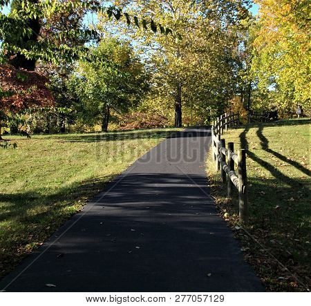 A Peaceful Afternoon Stroll On The Paved Walking Trail Around The Lake At Vastwood Park In Kentucky